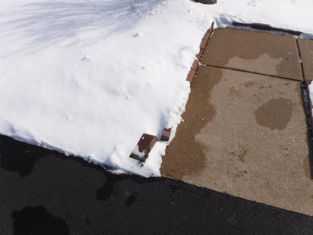 Raised Blicks along walkway Trip Hazard