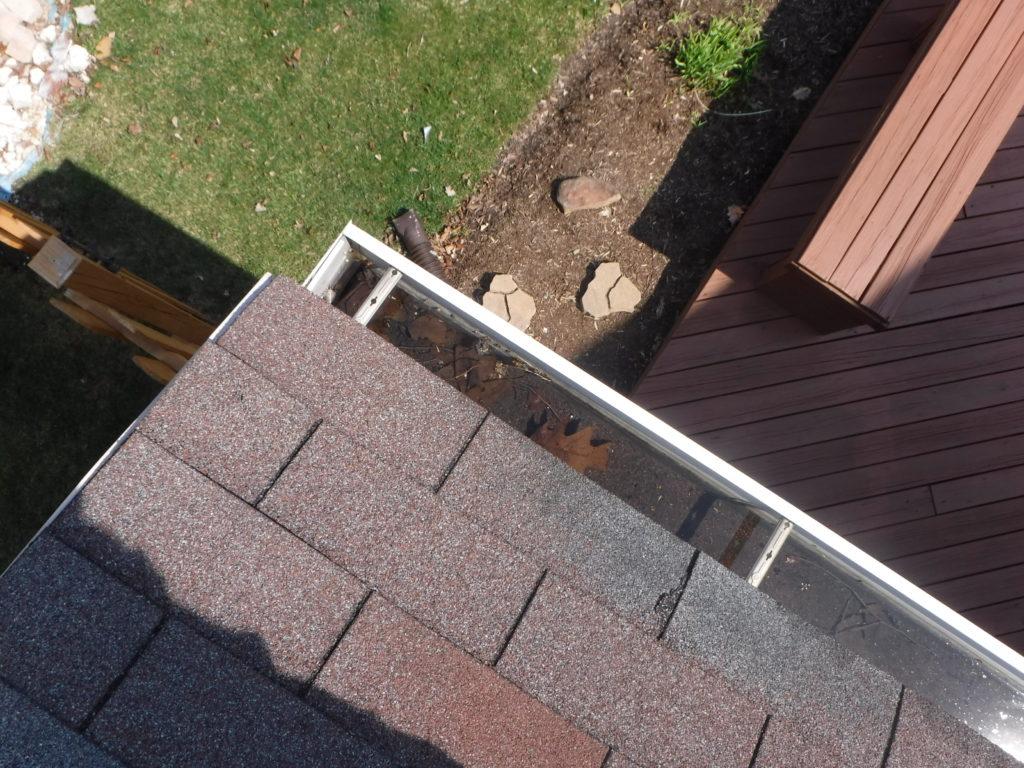 Improper slope, gutters not draining