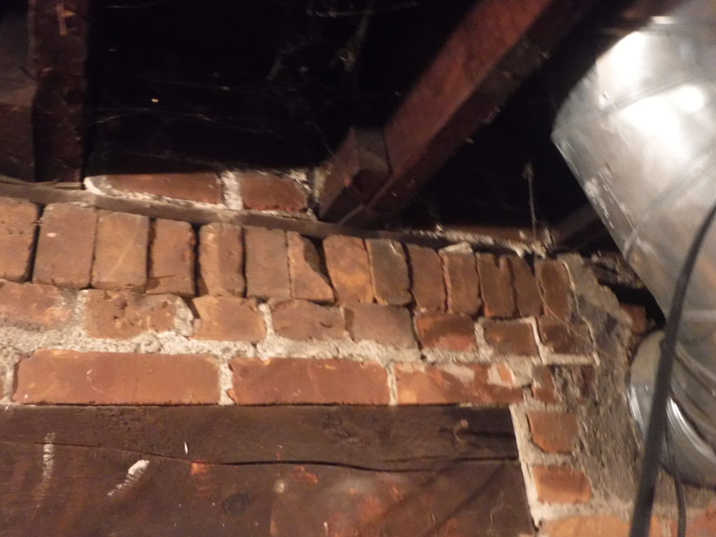 joist resting on failing support wall